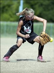 Tracie Weege tries to get the handle on a grounder.