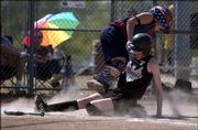 Lawrence's Rose Griffin, foreground in photo above, slides into catcher Kayla Sears during the Phenix's 12-2 rout of the Augusta Chill. The Phenix won Friday at the Youth Sports Inc. fields.