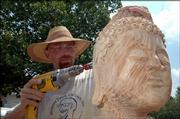 Dave Werdin-Kennicott works on the 7-foot-tall Buddha   sculpture he's creating for Dr. Dave and Gunda Hiebert.