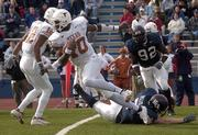 Kansas University's Nick Reid (7) misses a tackle on Texas quarterback Vince Young (10) as KU's David McMillan (92) tries to catch up to the play in the Longhorns' 27-23 victory last season. A missed tackled by Reid late helped UT win the game Nov. 13 in Lawrence, and the notoriety has followed Reid since.