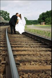 Kenneth Gibbon and Lucinda Linan symbolically walk down the tracks into their future at the Lawrence Union Pacific Depot, where they had a reception after their wedding at Danforth Chapel on KU's campus.