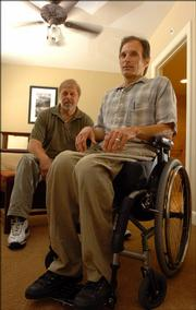 Lawrence residents Bob Mikesic, front, with Independence Inc., and Ray Petty, who provides technical assistance with the Great Plains ADA Center in Columbia, Mo., were two of the individuals involved in the renovations and wheelchair accessibility changes made at the newly remodeled Eldridge Hotel, 701 Mass.