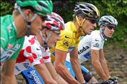 Winner Lance Armstrong, third from left, rides with best sprinter Thor Hushovd, left, best climber Mickael Rasmussen, second from left, and best young rider Yaroslav Popovych during the 21st and final stage of the Tour de France. The race ended Sunday in Paris.