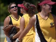 Missouri Intensity shortstop Caitlin Chapin, left, smiles after making a catch to end an inning, as teammates Amanda Sebree, middle, and 