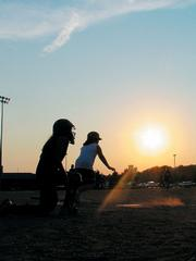The sun sets on a Jhawk Softball game at Youth Sports Inc.