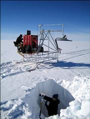 Kirby Mullenberg, a Kansas University undergraduate student, digs in a snow pit as Tim Rink, a graduate student, tests radar in Greenland. Mullenberg and Rink are among a team of KU researchers testing methods to measure the properties of snow to get a better idea fof how to predict polar ice sheet melting.