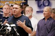 Teamsters President James P. Hoffa speaks as Andy Stern, right, leader of the Service Employees International Union, looks on at a joint news conference Monday in Chicago, where it was announced that the Teamsters and SEIU were going to leave the AFL-CIO and form a new labor federation.