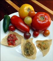 Free State Brewing Co., 636 Mass., uses fresh tomatoes to make, from left, salsa fresca with red tomatoes, green tomato salsa and yellow tomato salsa.