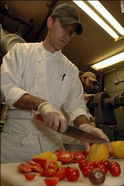 Free State Brewing Co. chef Rick Martin chops a medley of tomatoes used in salsas at the restaurant.