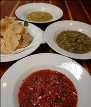 Salsas prepared by Free State chef Rick Martin, clockwise from top, are yellow tomato salsa, green tomato salsa and salsa fresca.