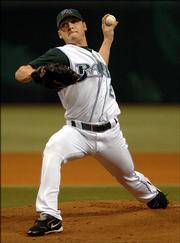Tampa Bay starter Scott Kazmir pitches against Kansas City during the first inning. Kazmir struck out 10 Royals in the Devil Rays' 10-5 victory Thursday.