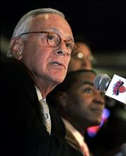 Larry Brown listens to questions at a news conference after being introduced by general manager Isiah Thomas, right, as the new coach of the New York Knicks. Brown was introduced Thursday in New York.