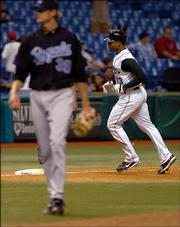 Tampa Bay's Carl Crawford, right, rounds the bases after hitting a two-run home run off Kansas City pitcher Kyle Snyder in the fifth inning. The Devil Rays beat the Royals, 10-5, Thursday in St. Petersburg, Fla.