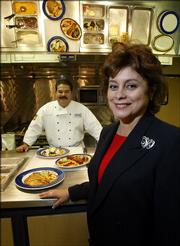 "Brinker International&squot;s Beto Rodarte, left, and Rebecca Johnson show some of the creations cooked up in the company&squot;s test kitchen. Brinker, which owns Chili&squot;s Grill & Bar, is using input from ""consumer insights"" team before altering menus."