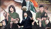 A boy plays soccer Thursday in front of an IRA mural in the Ballymurphy estate in west Belfast, after an IRA statement was released saying it will cease all violent activity and start decommissioning its weapons.