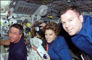 Astronauts Eileen M. Collins, mission commander, Stephen K. Robinson, left, mission specialist, and James M. Kelly, pilot, aboard Discovery on Thursday.