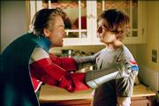 "Kurt Russell, left, stars as a renowned superhero trying to help his son (Michael Angarano) develop his own    inherited powers in the comedy-adventure ""Sky High"""