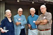From left, Katie Armitage, Bob Cobb, Don Marquis and Ken Armitage visit at the United Way's Spirit of Kaw Valley Assn. annual reception June 1 at the home of Mark and Sandy Praeger.