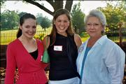 Margaret Perkins-McGuinness, left, manager of the Roger Hill Volunteer Center, visits with Jenna Sheldon-Sherman, center, Kansas University student representative for the United Way of Douglas County board of directors, and Linda Upstill, Spirit of Kaw Valley Assn. member. They attended the Spirit of Kaw Valley Assn. annual reception June 1 at the home of Mark and Sandy Praeger.