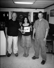 Ashley Anguiano, center, recently was honored for helping with Knights of Columbus projects. She is pictured with John Callewaert, left, grand knight of Knights of Columbus 1372, and Brian Walter, deputy grand knight. Ashley helped with the club's Halloween party, Tootsie Roll drive, Allen Fieldhouse cleaning project and barbecue.