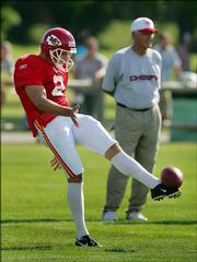 Kansas City punter Dustin Colquitt punts during practice. Colquitt, a Chiefs rookie shown Friday in River Falls, Wis., is hoping to end the team's punting woes.