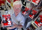 Tom Pyle, the patriarch of Pyle Meat Co. in Eudora, shows off his company's beef jerky, which is sold under the name Hombre.