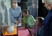 From left, Jim Huss, Atchison, Vita Tucker, Burlingame, Chris Garst, Topeka, and Anne Greitl, Topeka, view a pair of dinosaur egg fossils on display at the Kansas Museum of History in Topeka. A delegation from Henan Province in China presented the eggs to Gov. Kathleen Sebelius as a gift to Kansas. Huss, Tucker and Greitl are all volunteers at the museum, and Garst is the archeology lab supervisor. The four were viewing the eggs for the first time. The eggs could find a permanent home at Kansas University or in the Sternberg Museum in Hays.