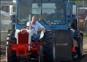 Johnny Grist, Maple Hill, sits comfortably atop his tractor as he pulls a semi during the 2005 Douglas County Fair Antique Tractor Pull on Thursday.