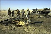 U.S. Marines on Thursday inspect the site where a roadside bomb destroyed their lightly armored vehicle Wednesday, killing 14 Marines and a civilian interpreter in Barwana, near Haditha, Iraq. This was the deadliest roadside bombing suffered by American forces in the Iraq war.