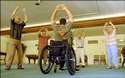 Steve Carrier, with back to camera, has been teaching self-defense to people with disabilities, but he also teaches tai chi to senior citizens. From left, Brower Burchill and his wife, Mary Burchill, along with Russell Mosser and his wife, Lorene Mosser, go through an evening session at Drury Place.