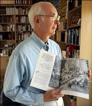 Former Kansas Supreme Court Justice Fred Six holds a copy of Kansas History magazine in which Six edited letters and reports from the 1863 raid of Lawrence by William Quantrill.