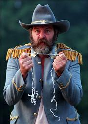 Don McIntyre portrays - at a re-enactment - Bill Anderson, a Missourian who joined Quantrill's army to avenge the death of his father.