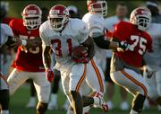 Kansas City Chiefs running back Priest Holmes breaks free for a run to the end zone during afternoon practice. As usual, Holmes sat out Saturday's morning session in River Falls, Wis.