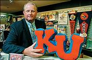 Paul Vander Tuig is in charge of Kansas University's trademarks. He shows some examples of KU products at the Kansas Union.