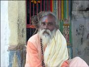This man is a saddhu, a wandering spiritual man who lives on alms. This particular saddhu gives nearly all he gets to feed the many destitute people around him.