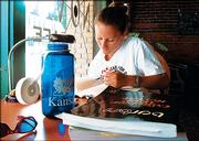 KU law school graduate Amy Kuhn, of Coldwater,   studies for the bar exam near the front       window of the Nova Cyber Cafe, 745 N.H. Downtown coffee shops are popular hangouts for Lawrence   students who are cramming for an exam or just out to socialize.