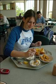 Samantha Remmers, now a sophomore from Sabetha, has lunch during spring semester at Ekdahl Dining Commons in Lewis Hall.