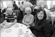 From left, Karmie Galle, retired Kansas Geological Survey Research scientist, his wife, Edna Galle, retired budget assistant to the School of Education dean, and Winnie Geissler, retired Anglo-Saxon instructor at Kansas State University, enjoy tea and coffee during a Wednesday gathering of the Endacott Society.