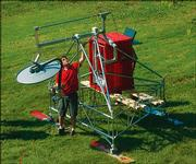 Timothy Rink, a research student in the Radar Systems and Remote Sensing Laboratory in Nichols Hall, works with a planwave radar sled constructed by lab members. The device will be sent to Greenland as part of a $19 million grant from the National Science Foundation to conduct polar research.