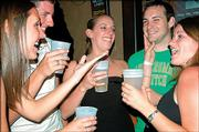 From left, Meghan Zavodny, a KU medical student from Shawnee; Matt Ross, a Shawnee senior; Eliza Zahn, a Littleton, Colo., graduate, and friends Aaron Gardner, of McLouth, and Kristen Camardelle, Mission; drink beers at the Cadillac Ranch, 2515 W. Sixth St. Zahn kept track of her budget during spring 2005 and says that going out was a major expense.