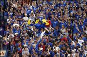 KU fans pass Big Jay after a touchdown against Kansas State in KU's 31-28 victory over their in-state rivals at Memorial Stadium in Lawrence.