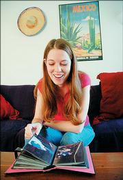 Jacquelyn Pedigo  looks through a photo album of her spring break trip.