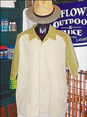 Dressing for the August heat can be hard to do, but not when wearing this sun hat ($19.98). This two-tone green shirt by Horny Toad ($57.98) is understated and simple. Both are available at Sunflower Outdoor & Bike Shop, 802 Mass.