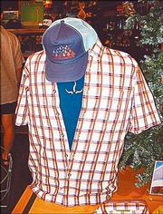Trucker hats are not yet out of style, as this look shows for just $23.98. The plaid shirt by Royal Robbins ($39.98) covers a simple shirt by Prana ($26.98). All are available at the Sunflower Outdoor & Bike Shop, 802 Mass.