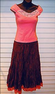 Weavers offers an array of sparkling looks for women. This pink Kaity top ($24.99) and a hobo brown skirt by Angie ($34.99) match perfectly.