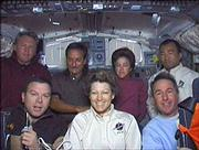 The crew, back row from left, are astronaut Andy Thomas, astronaut Charles Camarda, astronaut Wendy Lawrence and Japanese astronaut Soichi Noguchi, and front row from left, pilot James Kelly, commander Eileen Collins and astronaut Steve Robinson.