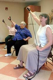 Babcock Place, 1700 Mass., is a meeting place for senior citizens wanting to exercise and lose weight. From left, Carolyn Greer, Norma Martin and instructor Gayle Sigurdson work on a stretching exercise recently.