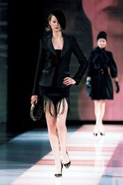 Emporio Armani's fall collection features a lot  of black - and many different textures and textiles.