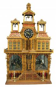 A bid of $2,128 bought this unusual folk-art clock at a Morphy auction in Denver, Pa. It is 40 inches high. With the help of a motor and some coins, the people inside move and the bells ring.