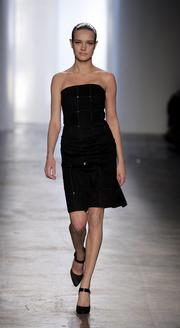 A model wears a black cashmere-sequin strapless dress with a grid pattern from Calvin Klein Collection's fall line.